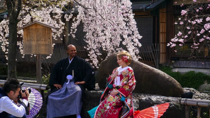 Couple wearing kimonos in a Buddhist temple